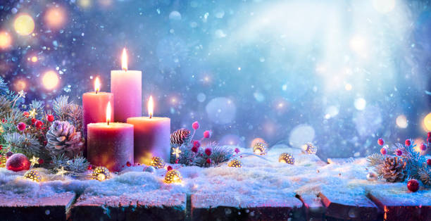 Advent - Four Purple Candles With Christmas Ornament In Shiny Night stock photo