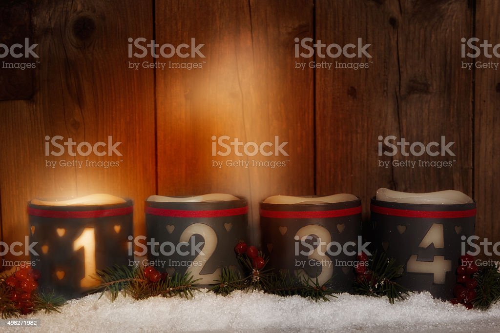 1. Advent, glowing candle with number 1 stock photo