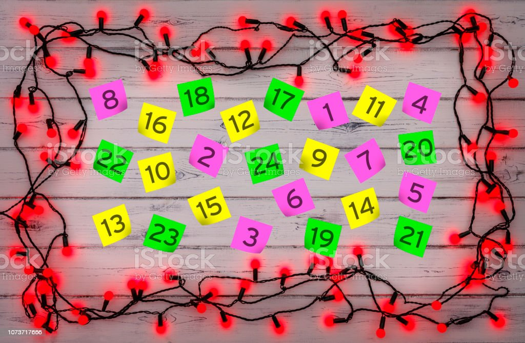 Advent numbered parer notes, with a border of red holly berry...