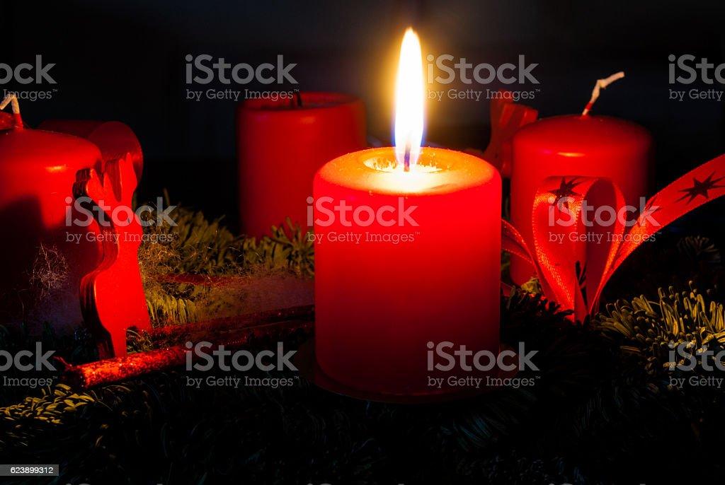 Advent wreath candle light to celebrate Christmas season stock photo