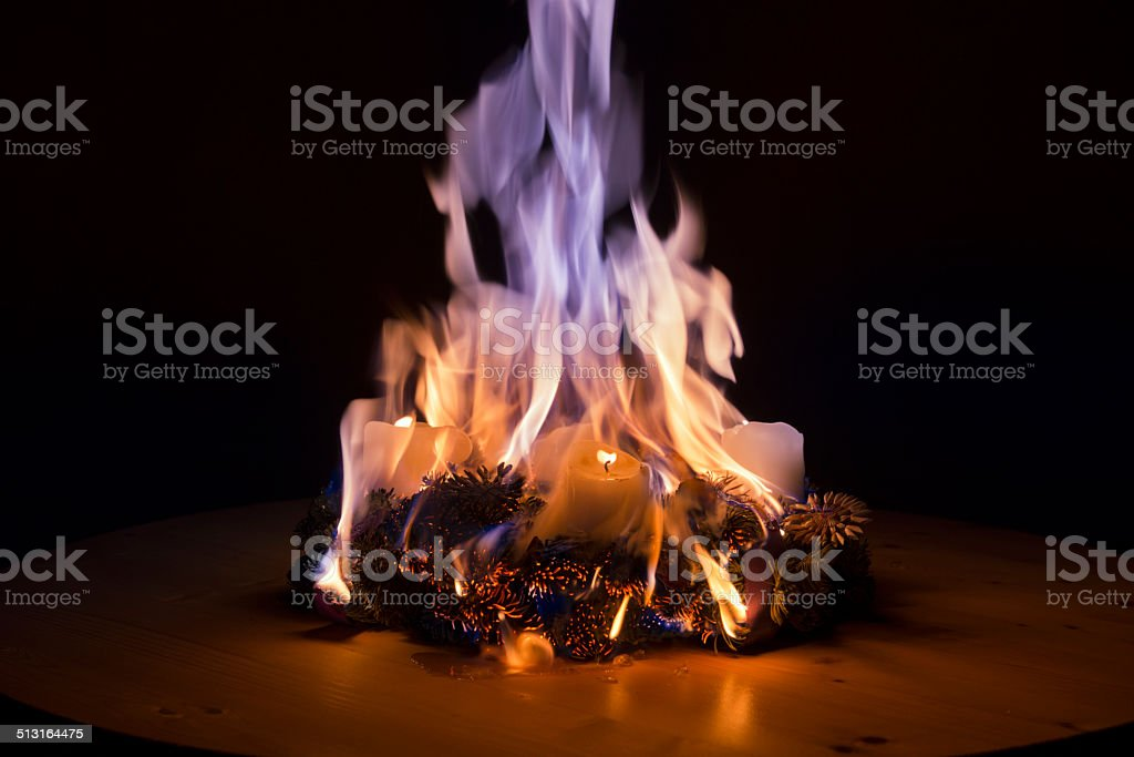 Advent wreath caught fire stock photo