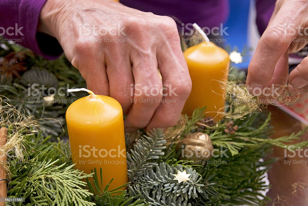 Advent wreath creation with hand royalty-free stock photo