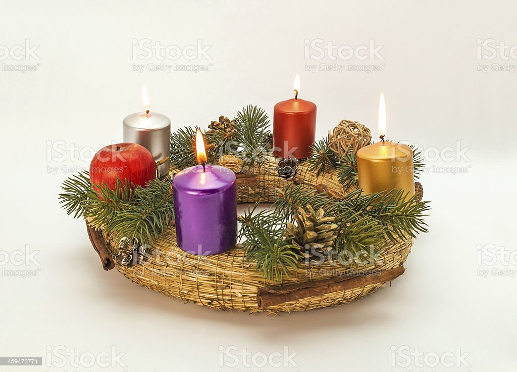 A homemade Advent wreath with white background.