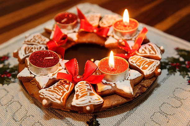 Advent wreath with candles in flame stock photo