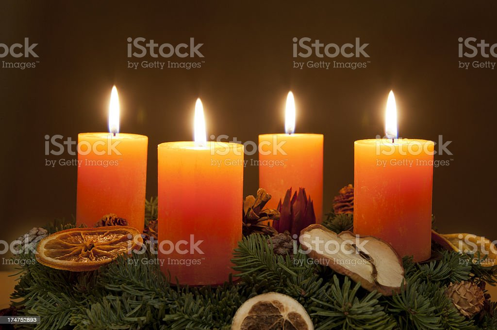 Advent wreath with candles lit stock photo