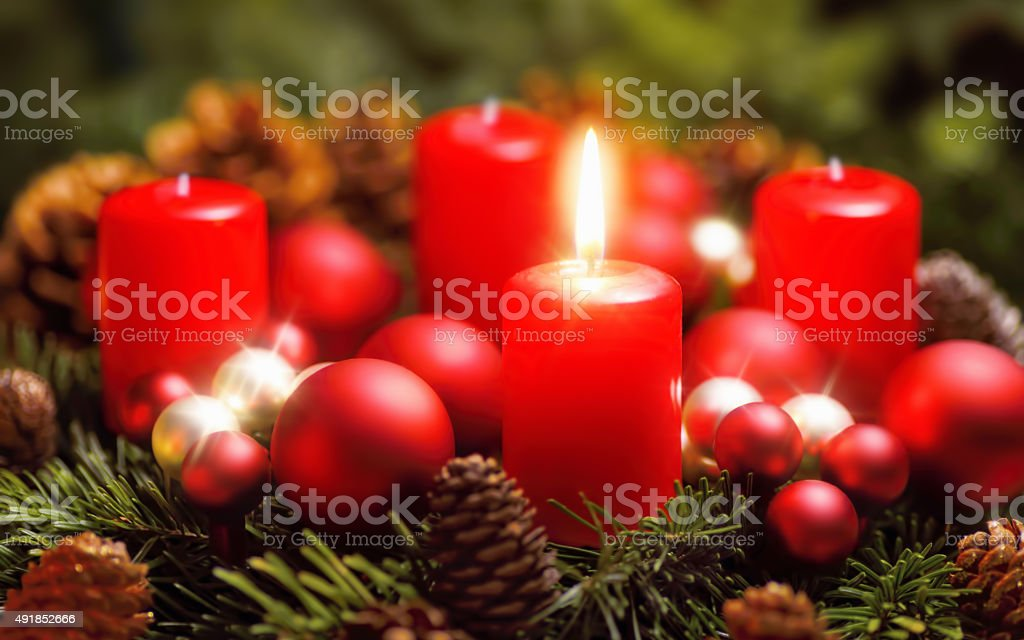 Advent wreath with one burning candle stock photo