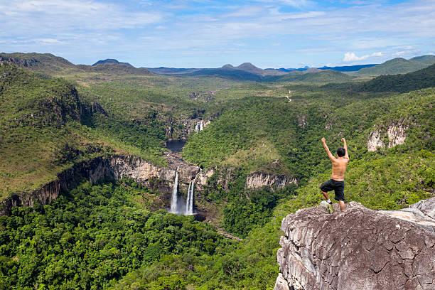 Adventure at Chapada dos Veadeiros Young adventure man lookint at Cachoeira dos Saltos at Chapada dos Veadeiros. São Jorge/GO/Brazil. goias stock pictures, royalty-free photos & images