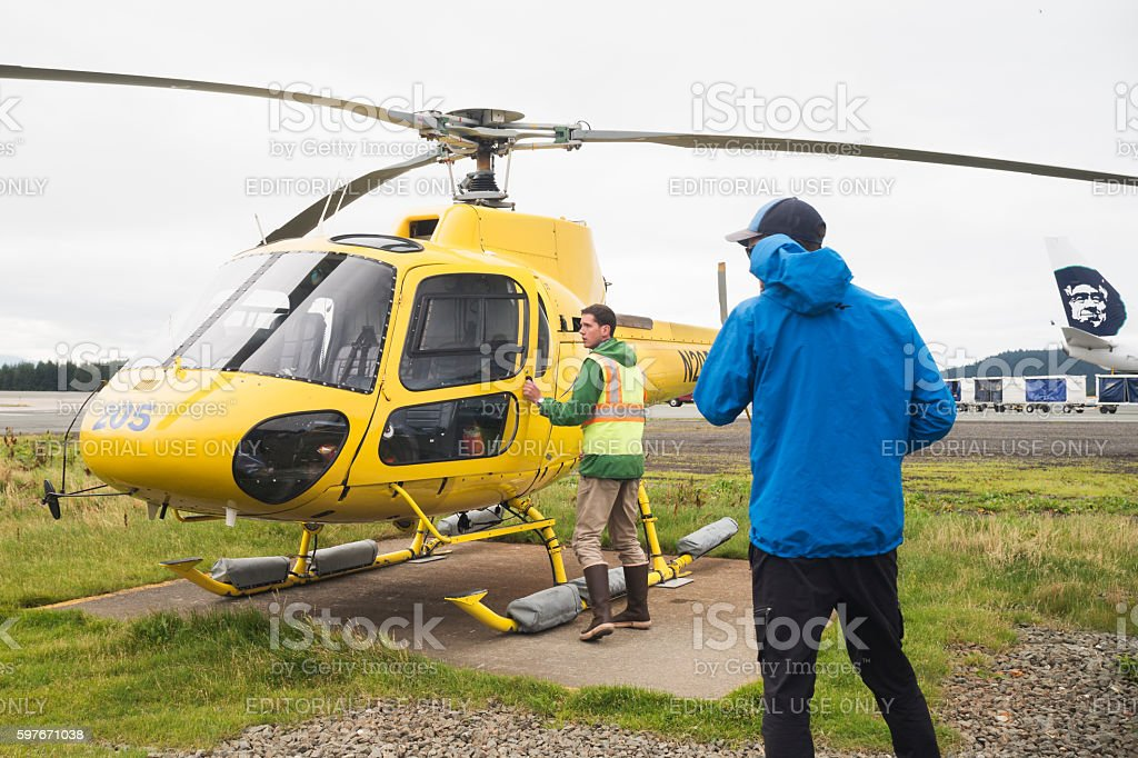 Adventure Awaits On A Yellow Helicopter Stock Photo