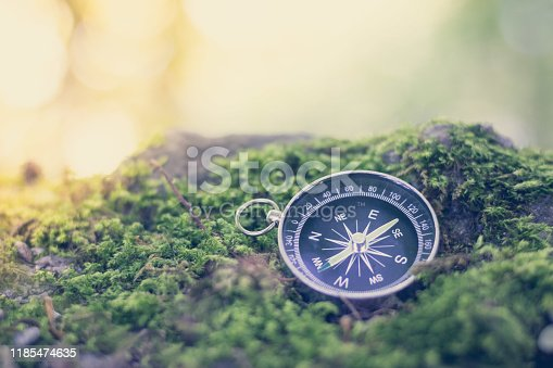 Vintage compass lying on the floor. Adventure and discovery concept. Drought.