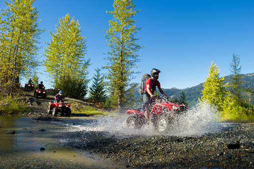 ATV adventure in Whistler, BC. Outdoor adventure on a summer vacation. Adreneline adventure in the mountains.