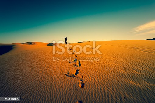 Woman and footprints in the desert