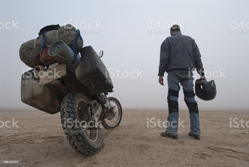 adventure motorcyclist in the fog stock photo