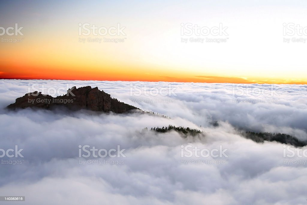 'Adventure', Mountain between clouds, Cloudscape royalty-free stock photo