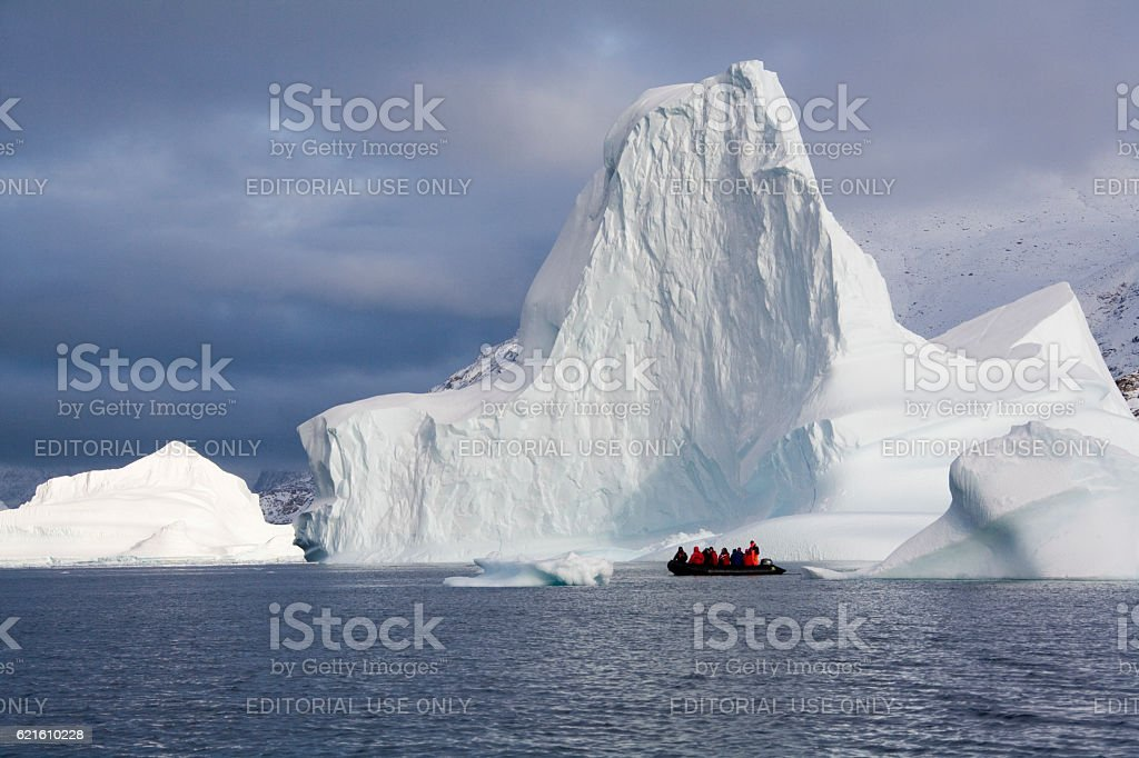 Adventure tourists and Iceberg in Scoresbysund in eastern Greenland stock photo