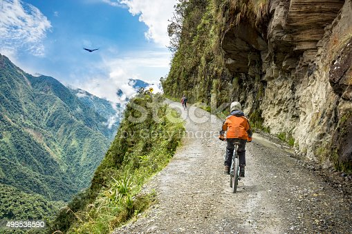 istock Adventure travel downhill biking road of death 499536590