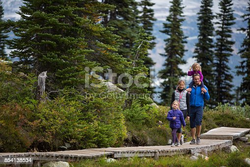An adventurous family head out on a hike in a wilderness area, Canada