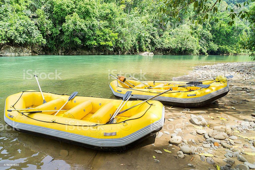 Adventure yellow white water raft stock photo