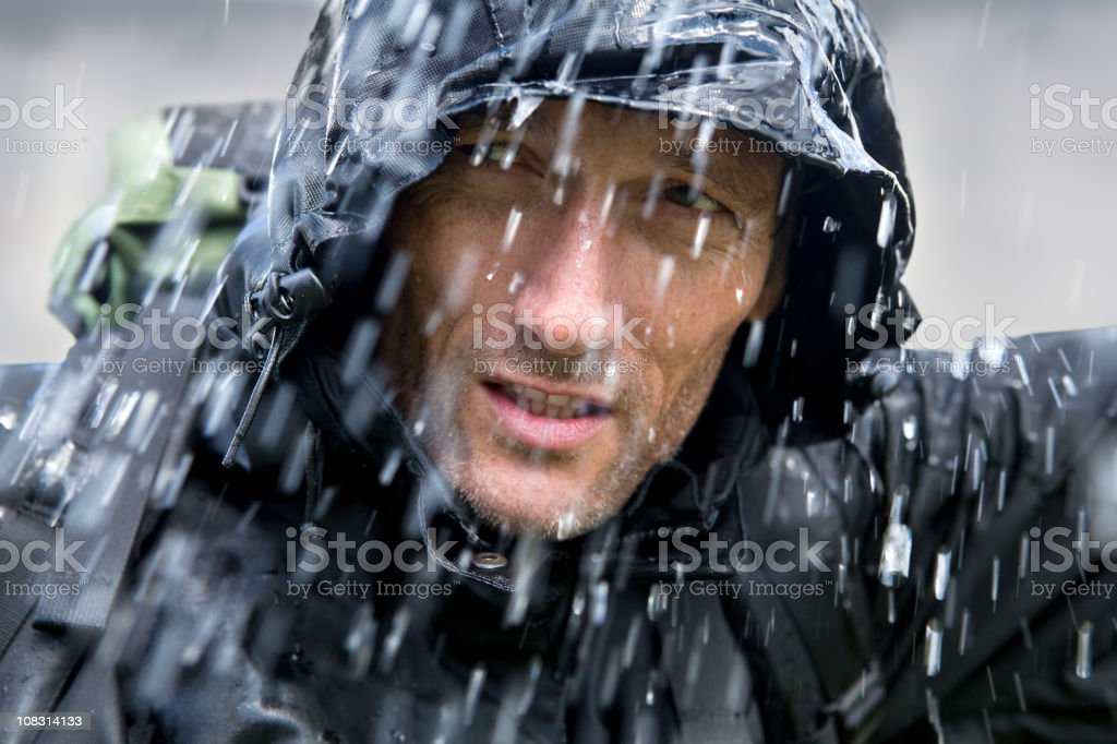 Adventurer in Typhoon stock photo