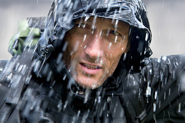 Adventurer in Typhoon  waterproof clothing stock pictures, royalty-free photos & images