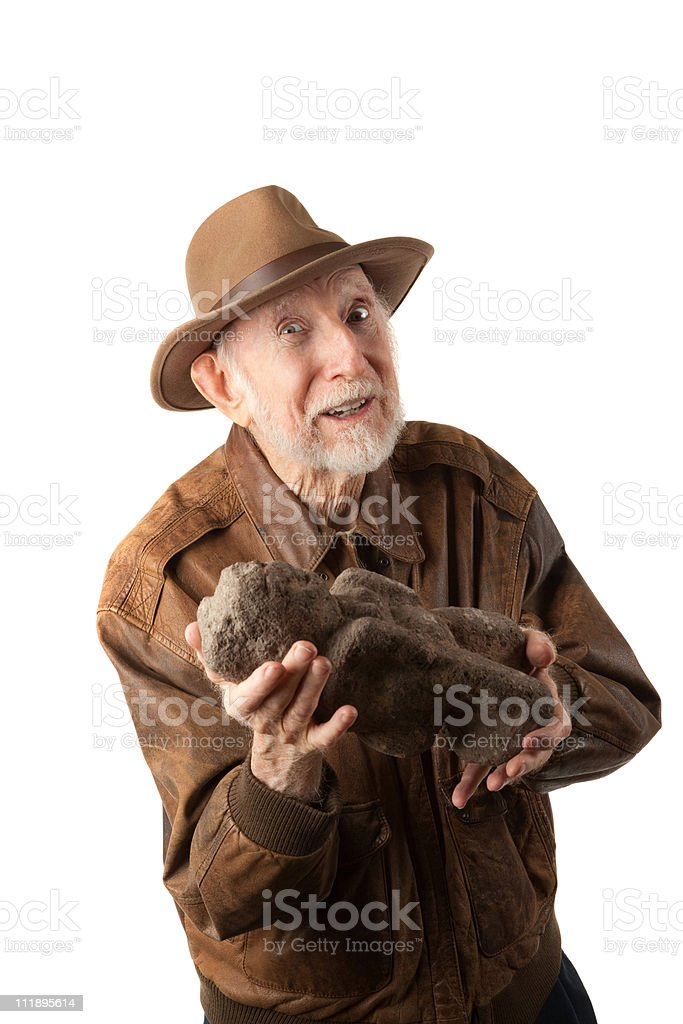 Adventurer or archaeologist offering to sell idol stock photo