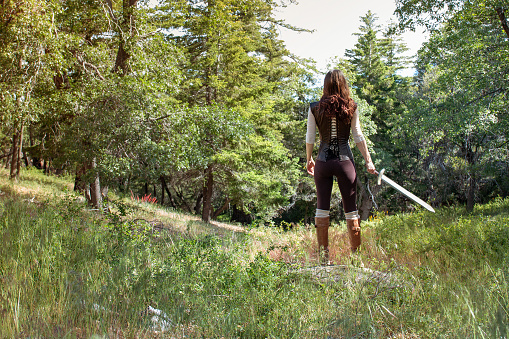 Female adventurer / LARPer in the forest