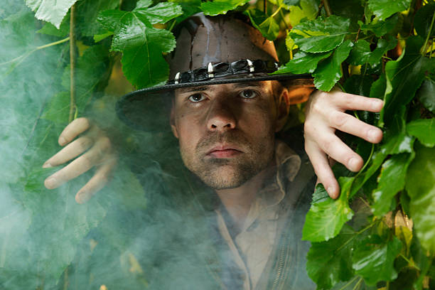 Adventurer Adventurer peaking through the jungle. explorer stock pictures, royalty-free photos & images