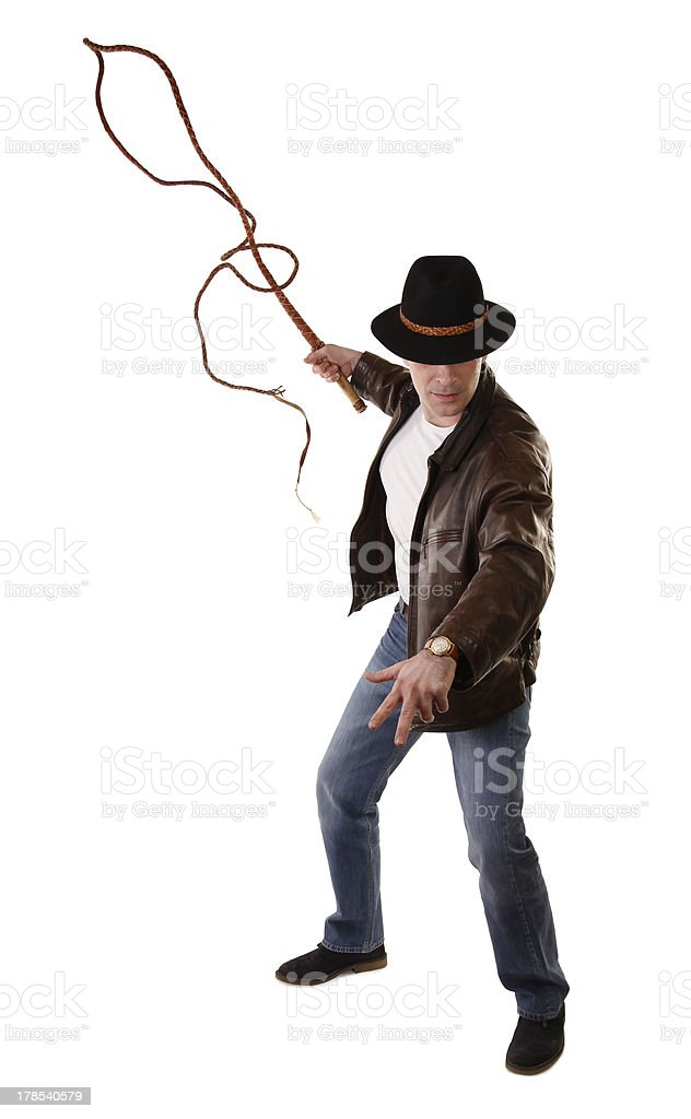 Adventurer treasure hunter is swinging with bullwhip stock photo