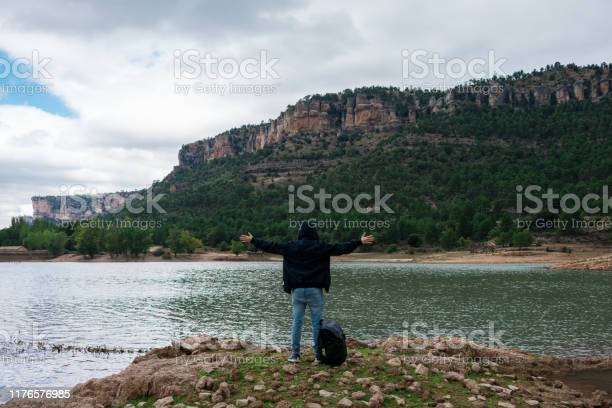 Adventurer with his backpack in a lake of spain picture id1176576985?b=1&k=6&m=1176576985&s=612x612&h=s6d8bex9pt07cbcdsmiadxhnkzhojp5zwhn f06vcaw=