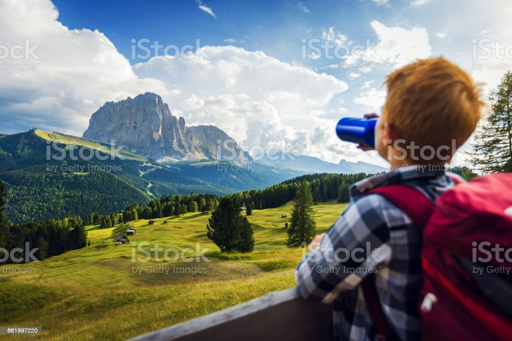 Adventures on the Dolomites: boy drinking water - foto stock