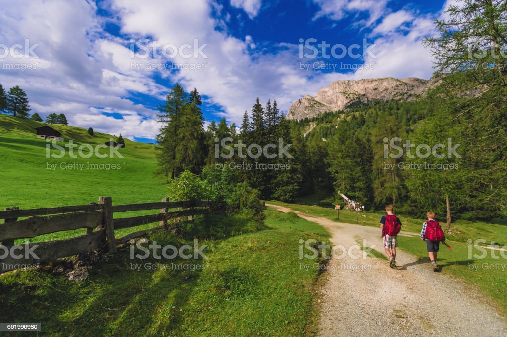 Adventures on the Dolomites: brothers together royalty-free stock photo