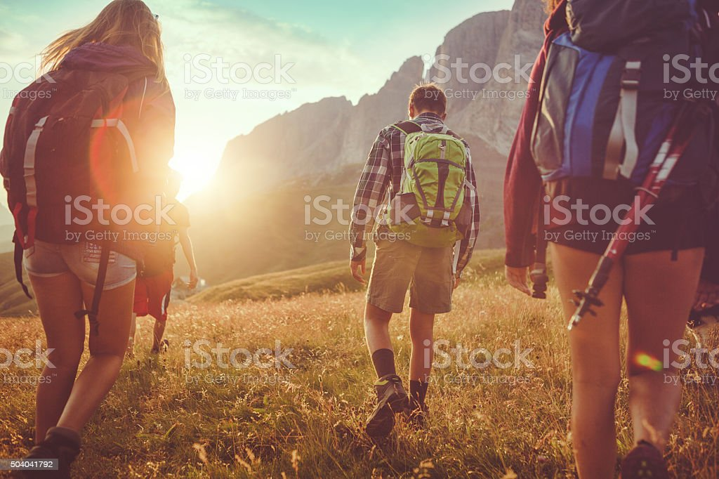 Adventures on the Dolomites: friends hiking stock photo