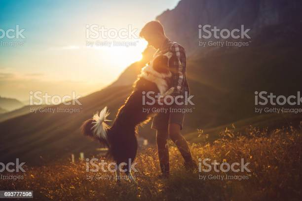Adventures on the dolomites friends hiking with dog picture id693777598?b=1&k=6&m=693777598&s=612x612&h=bkk6 re ui9ai5amfxghur920gjj6ii zql2knfxusq=
