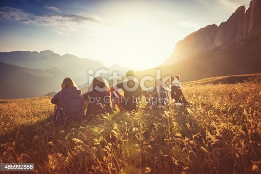 A group of teenage friends, together with a dog (border collie), adventures on the mountain, on the Italian Dolomites.