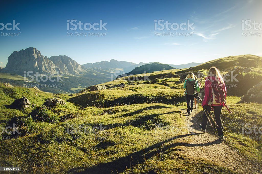 Adventures on the mountain: women together stock photo