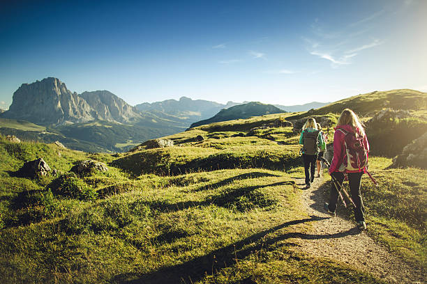adventures on the mountain: women together - hiking stock photos and pictures