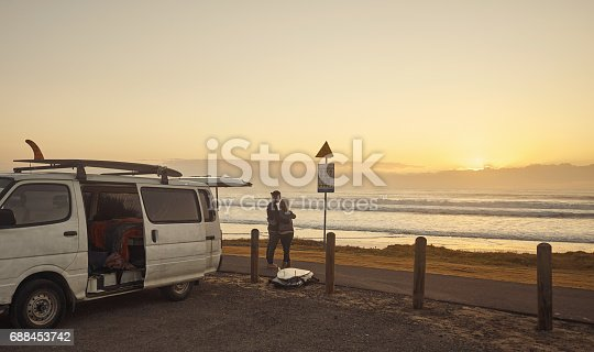 Shot of a young couple admiring the view at the beach while on a roadtrip
