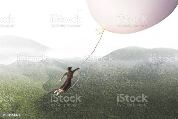 Photo of adventurous journey of a woman carried by a giant balloon