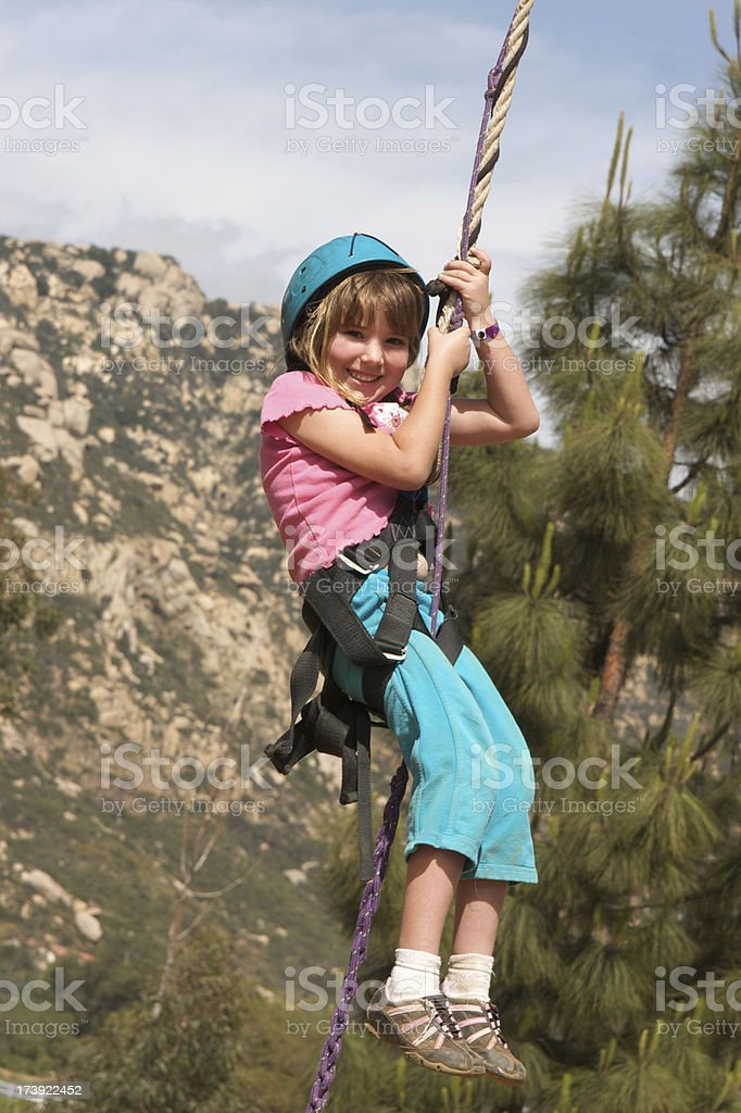 Adventurous Little Girl on a Zip Line royalty-free stock photo