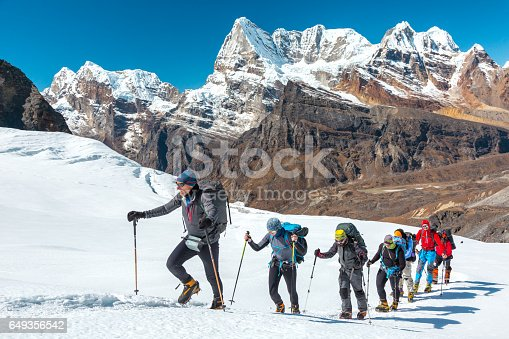 istock Adventurous People making Ascent to high Mountain walking on Glacier 649356542