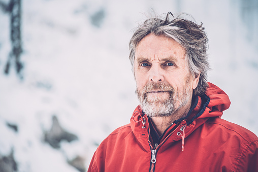 Adventurous Senior Man Hiking in Forest, Snowing, Julian Alps, Europe