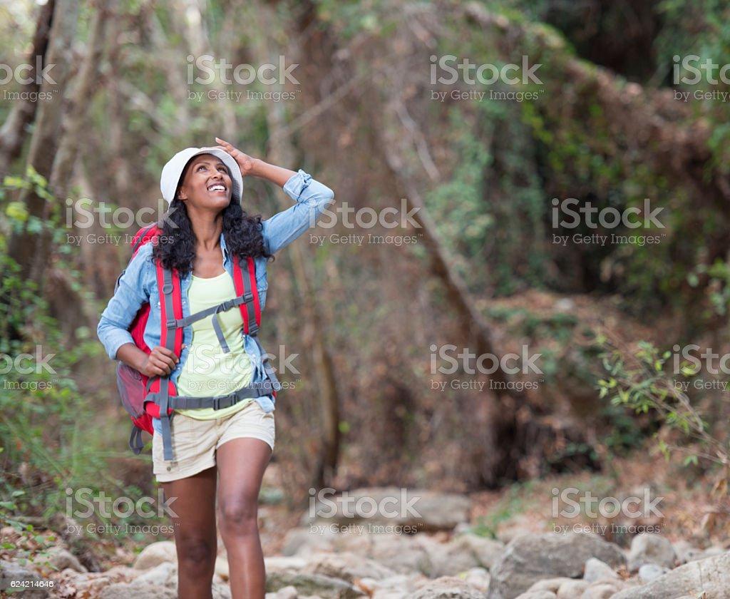 Adventurous tourist woman enjoying nature. stock photo