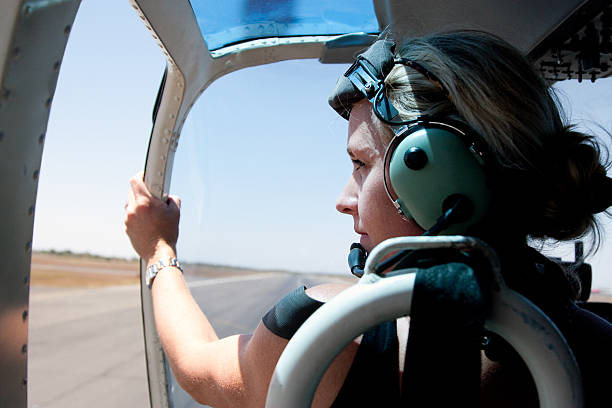 Adventurous Woman in Helicopter stock photo