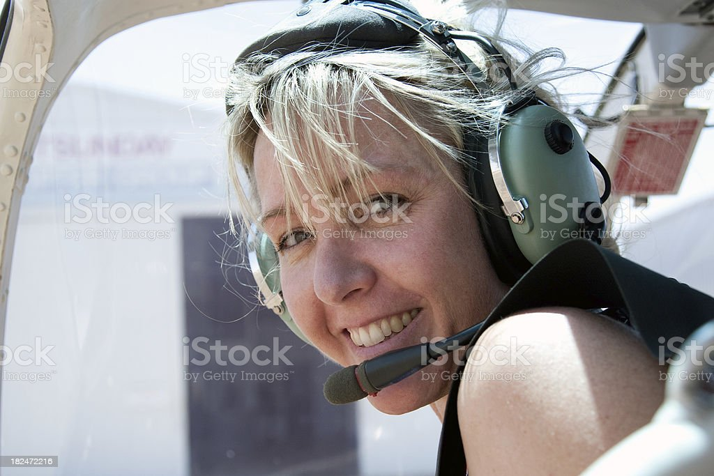 Adventurous Woman in Helicopter wearing headset royalty-free stock photo