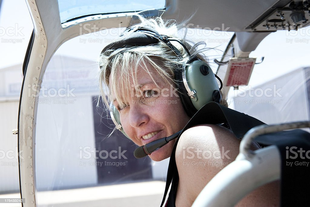 Adventurous Woman in Helicopter with radio headset royalty-free stock photo