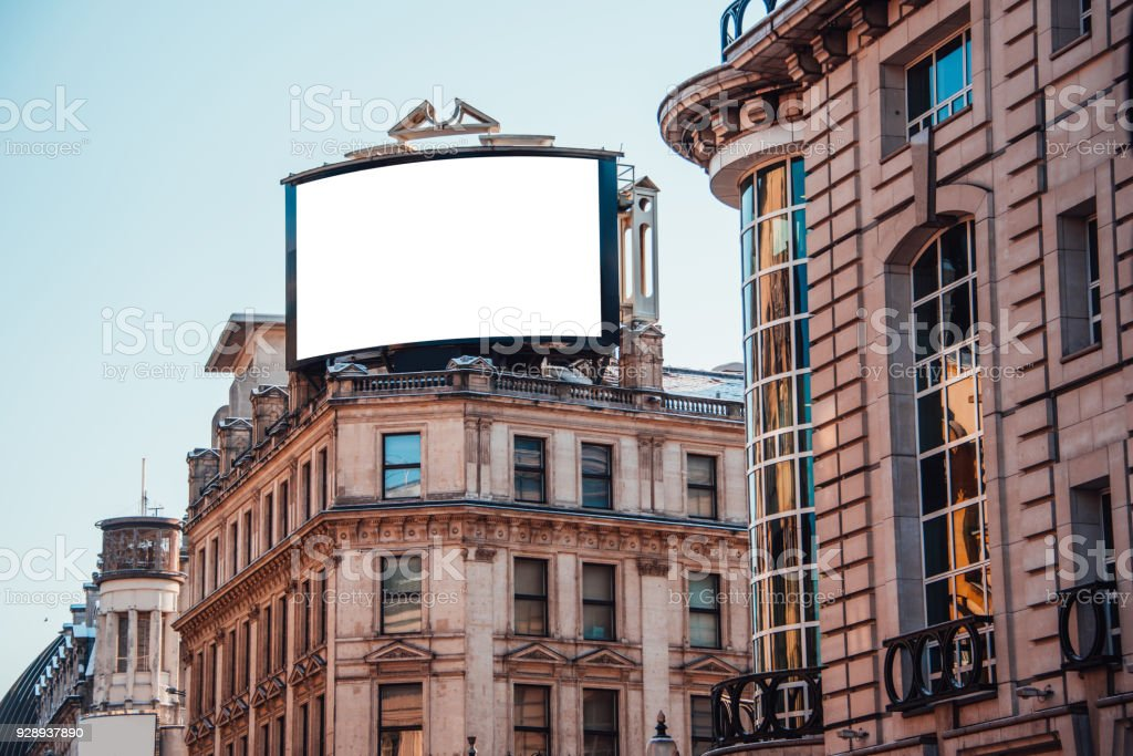 Advertisement panel on top of building stock photo