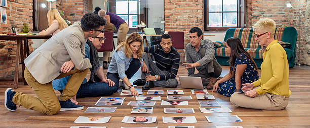 Advertising agency team choosing model for campaign stock photo