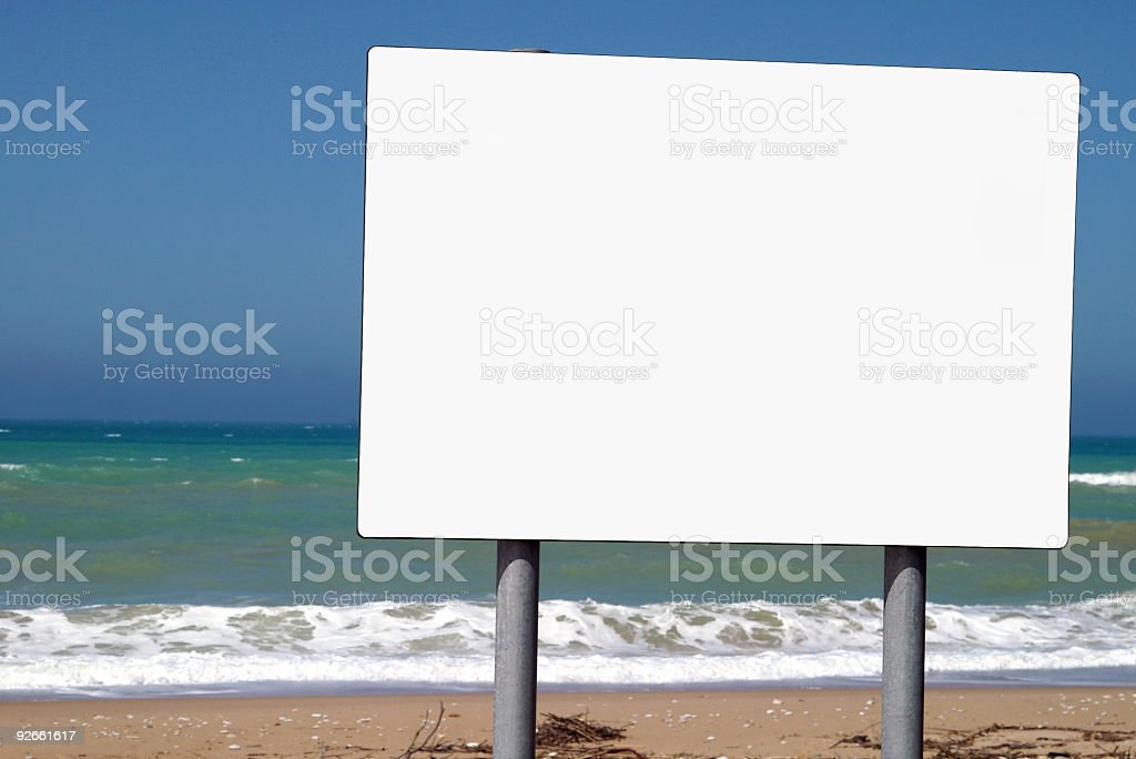 Advertising board on background ocean and sky royalty-free stock photo