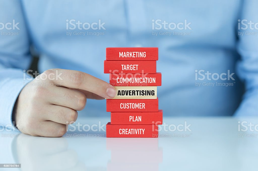 Advertising Concept with Related Keywords on Wooden Blocks stock photo