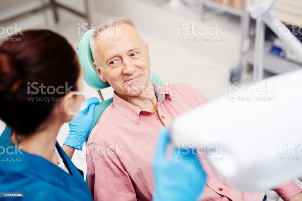 Advice of dentist stock photo