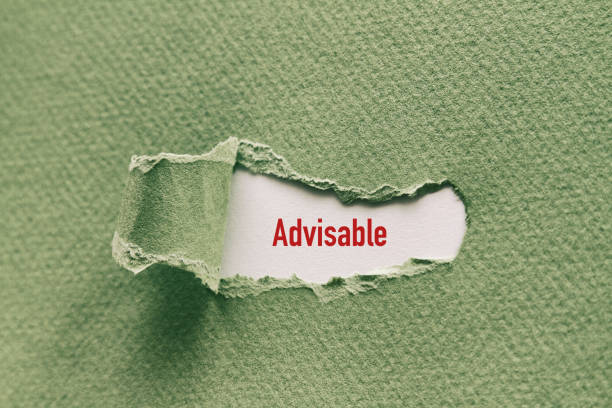 Advisable Advisable written under torn paper. advisable stock pictures, royalty-free photos & images